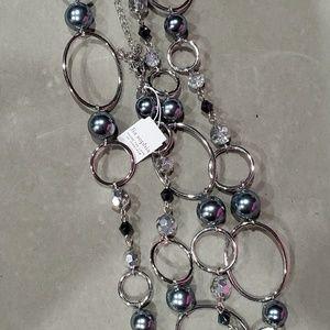 Lia Sophia beautiful silver, ivory necklace.